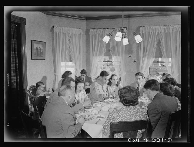 Southington, Connecticut. The family of Ralph Hurlbut. A Sunday dinner honoring Corporal Robert Hurlbut, twenty-one, home on his first furlough from the army. All of the Hurlbuts are on hand for the occasion, including the married and grandchildren. Corporal Robert is not the only Hurlbut serving his country. The elder Hurlbut works in a defense plant and Mrs. Hurlbut and all of the children old enough are enrolled in various American voluntary services