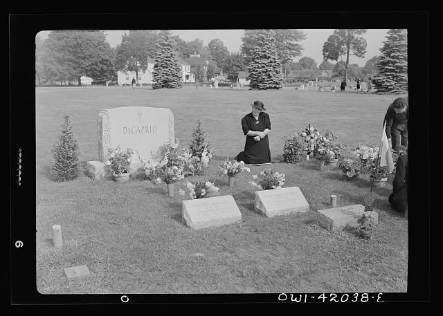 Southington, Connecticut. Woman praying on All Souls' Day in the Saint Thomas cemetery