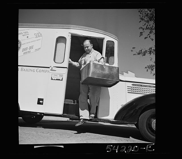 Washington, D.C. A Charles Schneider Baking Company delivery truck displaying a United States Truck Conservaton Corps pledge, showing a driver alighting with a basket of bread