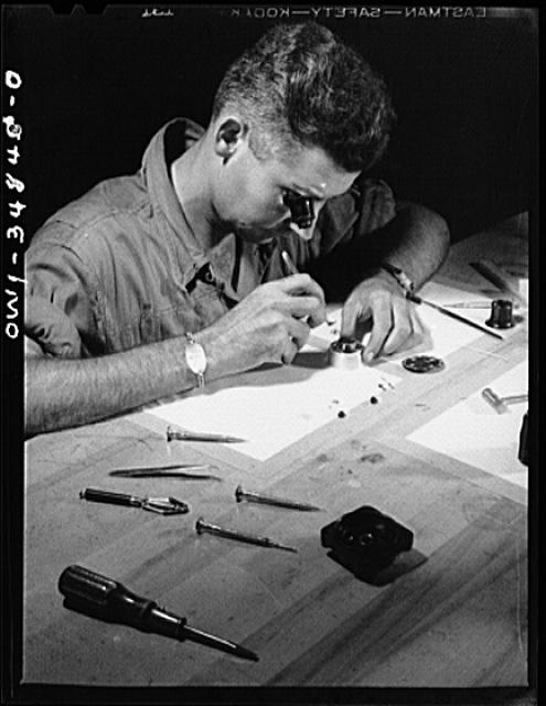 Warner Robins, Georgia. Air Service Command, Robins Field. Staff Sergeant C.A. Jones, an instrument repair man, working on an aircraft clock. Sergeant Jones comes from Lloyd, Florida