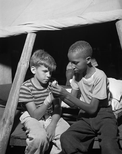 Southfields, New York. Interracial activities at camp Nathan Hale, where children are aided by the Methodist Camp Service. First aid