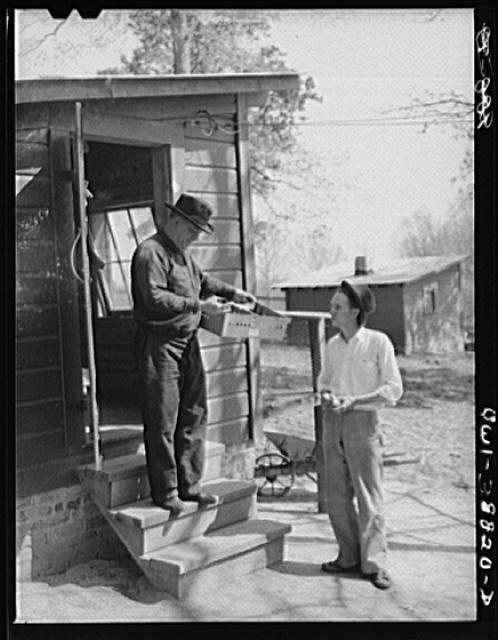 Miscellaneous lot of photographs by Barbara Wright. National Youth Administration (NYA), Works Progress Administration (WPA) and Civilian Conservation Corps (CCC). Habersham, Georgia. NYA youth learning modern incubator techniques from a local farmer