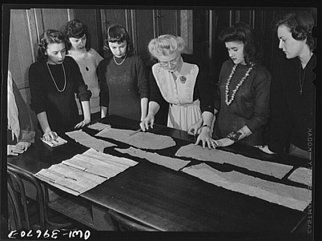 Washington, D.C. Learning to cut from a pattern in a sewing class at Woodrow Wilson High School
