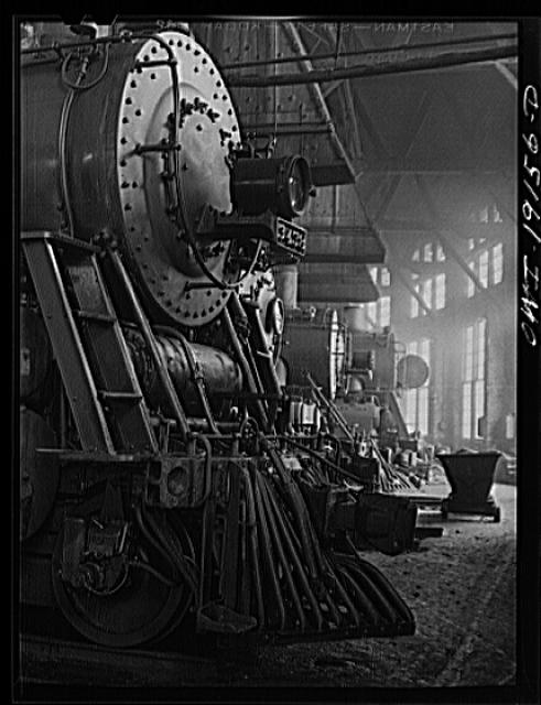 Shopton, near Fort Madison, Iowa. Engines in the Atchison, Topeka and Santa Fe Railway roundhouse. Note train control mechanism on truck wheel of the engine in foreground