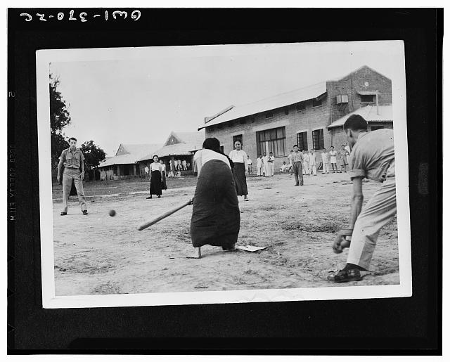 American soldiers in India have taught these Burmese nurses to play softball and they report the girls make good competition despite the long wrap-around skirts which interfere somewhat with their base running
