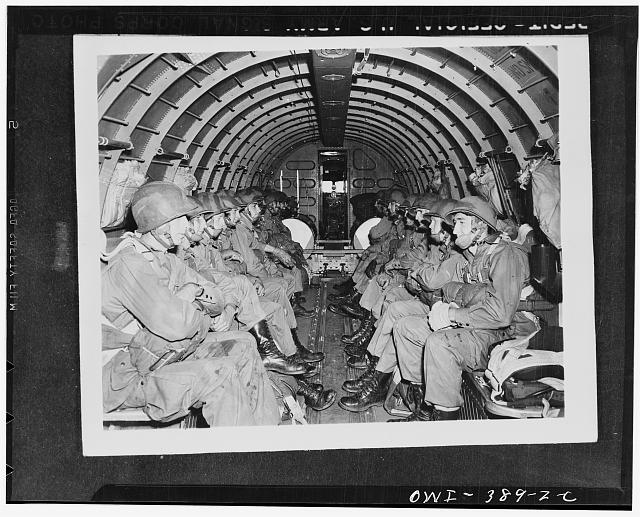 U.S. paratroopers awaiting orders to jump during manuevers somewhere in England