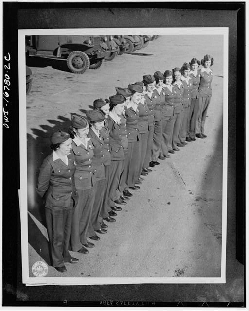 San Antonio, Texas. The gags about women drivers fall flat at the United States Army quartermaster depot, where 35 young ladies are replacing men drivers and have rolled up an enviable service and safety record. They handle all types of equipment. They are lined up in their regulation uniforms consisting of blue slacks, coat, and overseas cap, white shirt, dark brown or blue socks, and brown oxfords