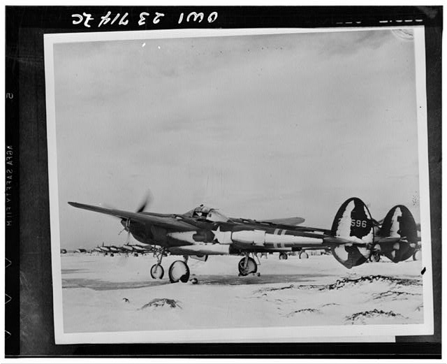 United States Army Air Forces P-38 being warmed up in a snow swept air field somewhere in Iceland