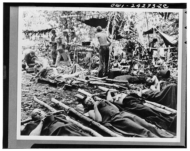 Wounded waiting at a portable hospital for evacuation. Australia