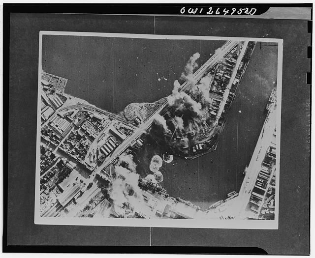 Royal Air Force Bostons in daylight raid on Saint Malo. Boston bomber, escorted by fighters, on July 31 carried out successful attack in daylight on harbour works and installations at Saint Malo, and returned with photographs providing evidence that their bombs were well in the target area. At least sixteen bombursts can be seen in and around the bassin Dunguay Trouin, eleven in, or adjecent to, a builders' yard. Of the bursts in the bassin itself, one is a near miss on a 300 foot motor vessel, another a near miss on three barges on the opposite side of the bassin, and a third is either on the stern or on the quay alongside a motor vessel of 250-300 feet