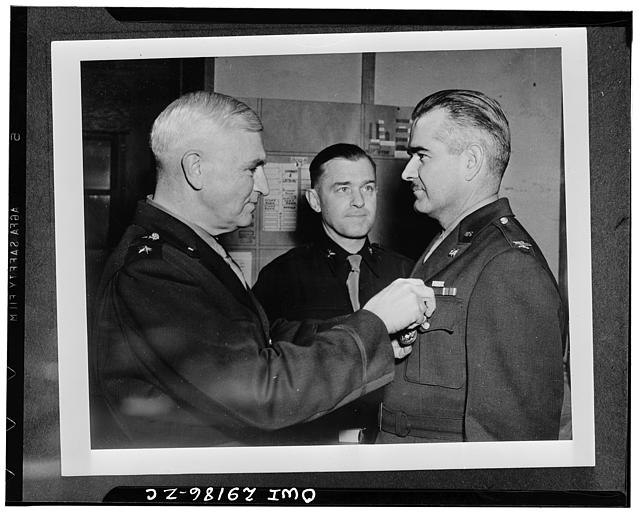 Colonel Benjamin B. Talley, engineering officer who planned and supervised the construction of all army installations in Alaska, receiving the Distinguished Service Medal from Major-General Simon Bolivar Buckner, Jr., commanding general of the Alaska Defense Command at his headquarters in Alaska