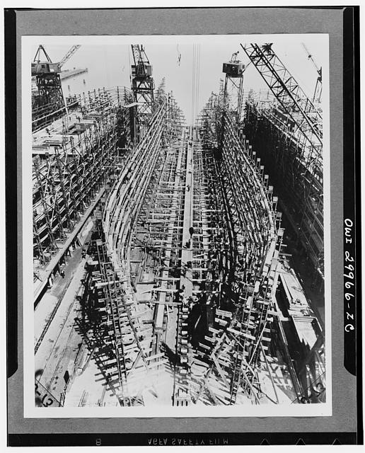 Bethlehem Fairfield shipyards, near Baltimore, Maryland. Construction of a Liberty ship. Laying of the keelplates to which will be attached the vertical keel