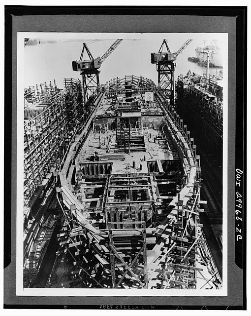 Bethlehem Fairfield shipyards, near Baltimore, Maryland. Construction of a Liberty ship. On the tenth day 1575 tons of ship are in place. The lower deck is being completed and the upper deck amidship is erected with the inner stack installed