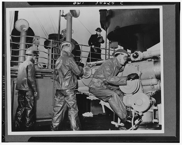 Merchant ship U.S. Navy gun crew getting the range on its four-inch .50 calibre gun on a cold day