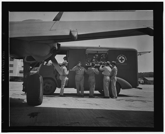 Washington, D.C. A new mobile canteen, recently received by the District of Columbia Red Cross, serving the armed forces around the district. Mrs. Harold Hoskins and her three assistants are feeding transient pilots and crews at a nearby Army airport