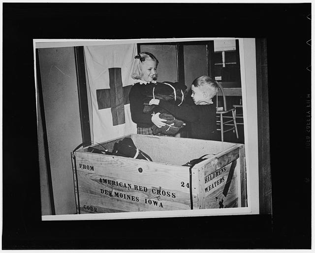 Des Moines, Iowa. Members of the Junior Red Cross packing children's sweaters for war refugees