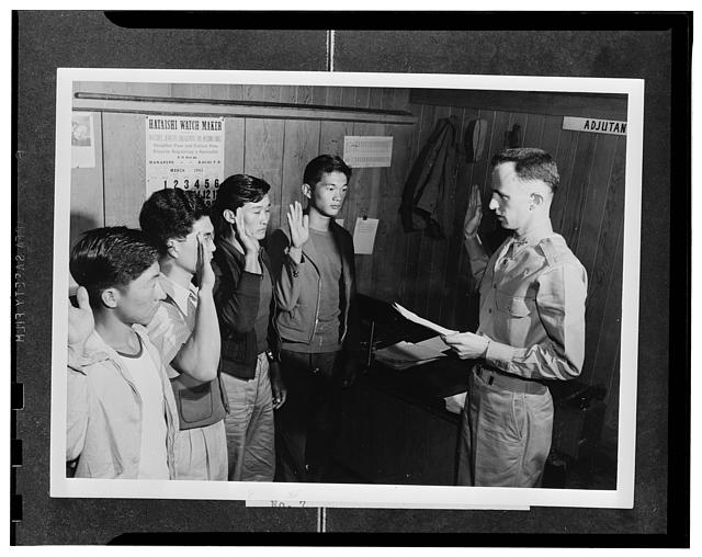 Kauai District, Territory of Hawaii. Major Charles V. McManus administering the oath to four AJA volunteers