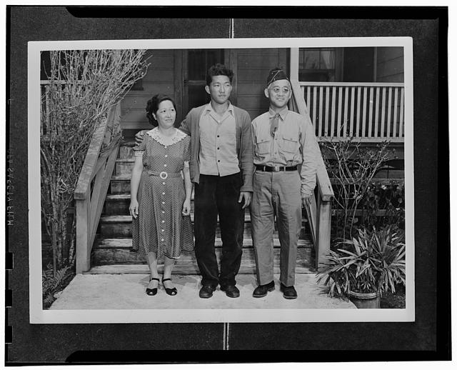 Kauai District, Territory of Hawaii. Herbert Kondo, an AJA volunteer, with his father and mother. The elder Kondo is a veteran of World War I