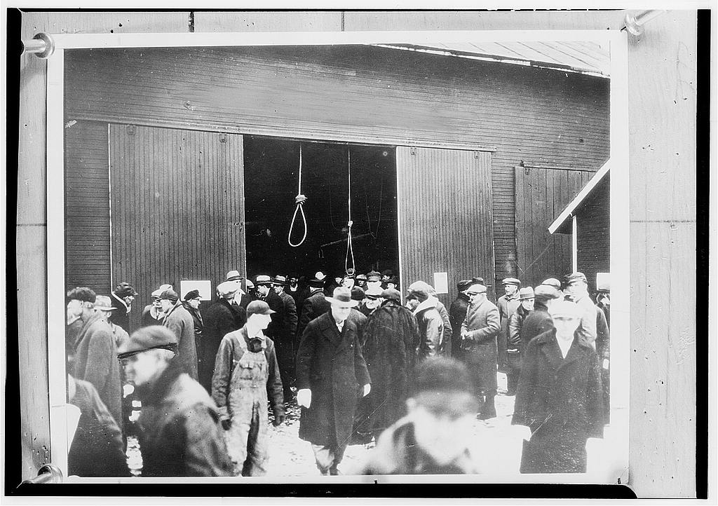 Two hangman's nooses hang as a grim warning to prospective bidders on this foreclosed farm. In this way many farms sold for only a few cents until the Farm Debt Adjustment Committee came into being. May 1936