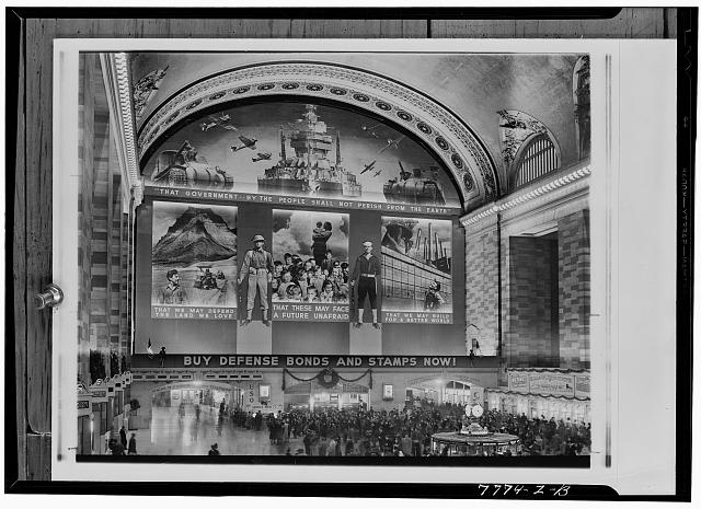 New York, New York. Photomural to promote the sale of defense bonds, designed by the Farm Security Administration, in the concourse of the Grand Central terminal
