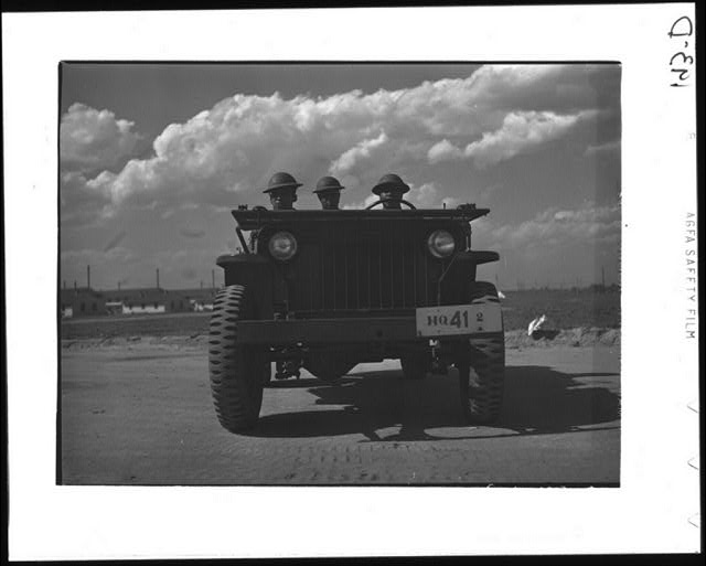 Fort Bragg, North Carolina. Sergeant Franklin Williams, left, in jeep