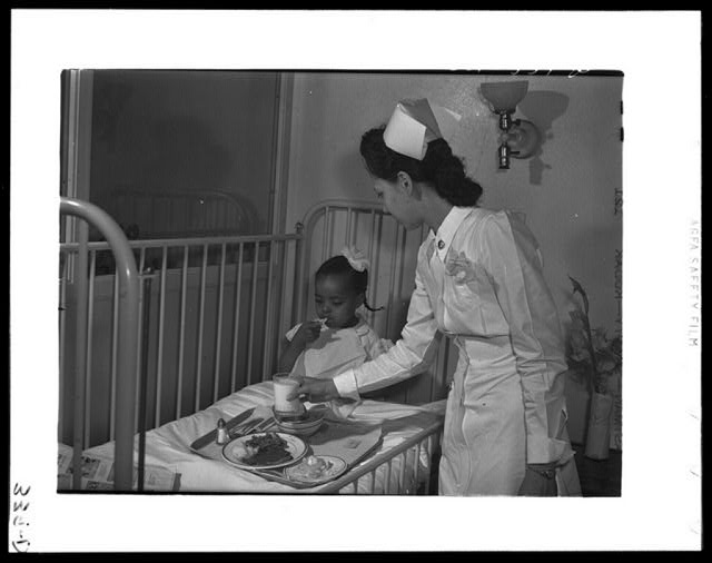 Chicago, Illinois. Provident Hospital. Lunch time in the children's ward