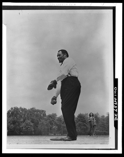 [Paul Robeson playing softball with other members of Othello production, Central Park, New York City]