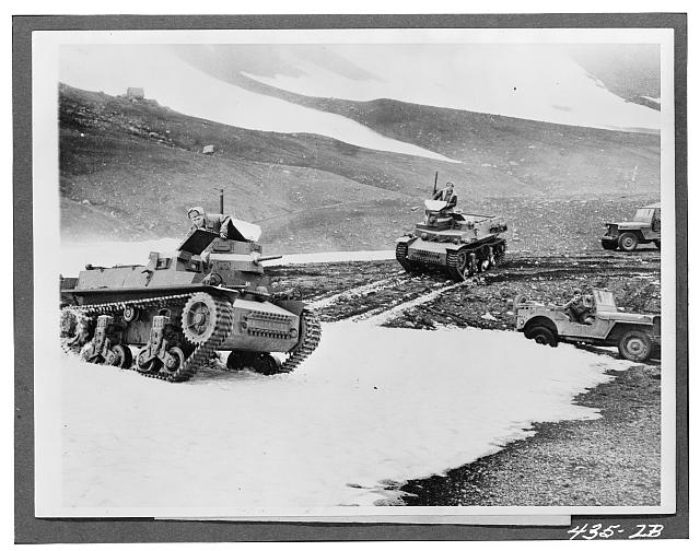 Tanks maneuvering in a mountain pass in Alaska