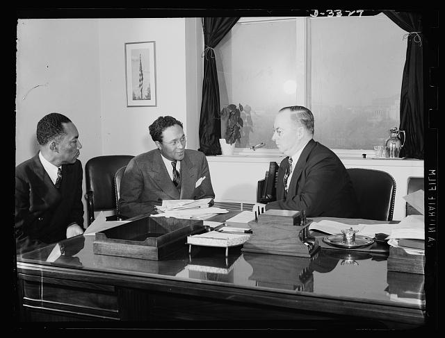 Left to right: Ferdinand Smith, National Secretary, National Maritime Union. He is from New York. Alderman Earl B. Dickerson of Chicago, a member of the President's Committee on Fair Employment Practices; and Donald M. Nelson, Chairman of the War Production Board. These two men came in on an appointment arranged by Phil