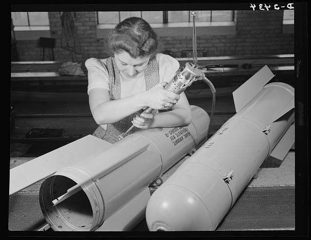 Conversion. Toy factory. With this same electric screwdriver, Stephanie Cewe used to work on the manufacture of toy trains. Now she's using it in far more important work--that of assembling flare casings. A. C. Gilbert Company, New Haven, Connecticut
