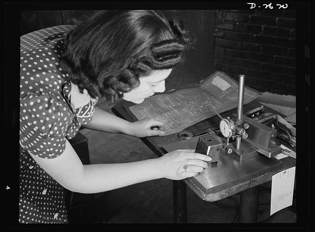 Conversion. Safety razor plant. Estelle Wilson, one of a New England razor factory's many women workers, checks completed V-blocks with blueprint specification. Because of their previous training, reading blueprints is no novelty to women employed in this plant which is now producing tool posts under subcontract. Gillette