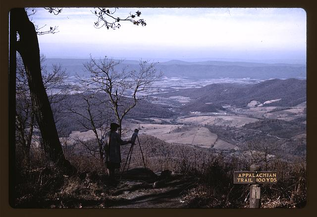 A woman painting a view of the Shenandoah Valley from the Skyline Drive, near an entrance to the Appalachian Trail, Virginia