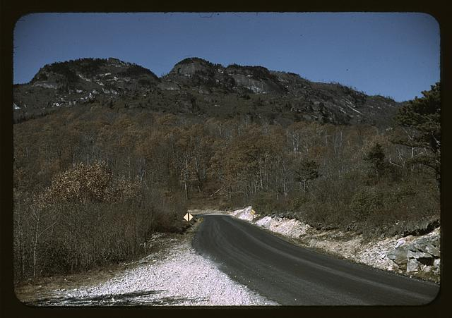 The road along the Skyline Drive, with a light snowfall in the rocks beside, Virginia