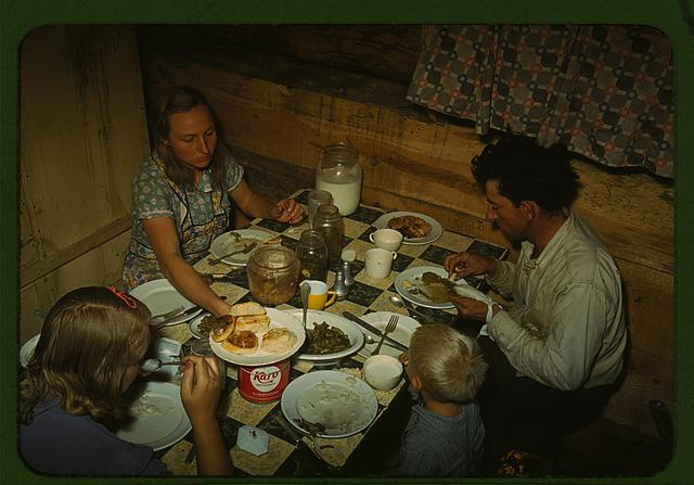 The Faro Caudill [family] eating dinner in their dugout, Pie Town, New Mexico