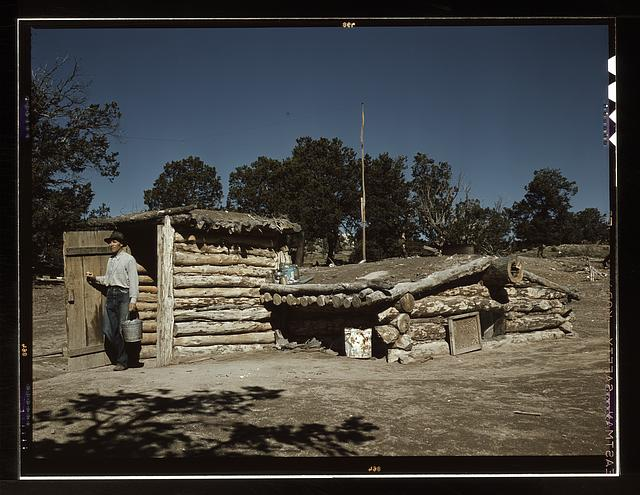 Mr. Leatherman, homesteader, coming out of his dugout home, Pie Town, New Mexico