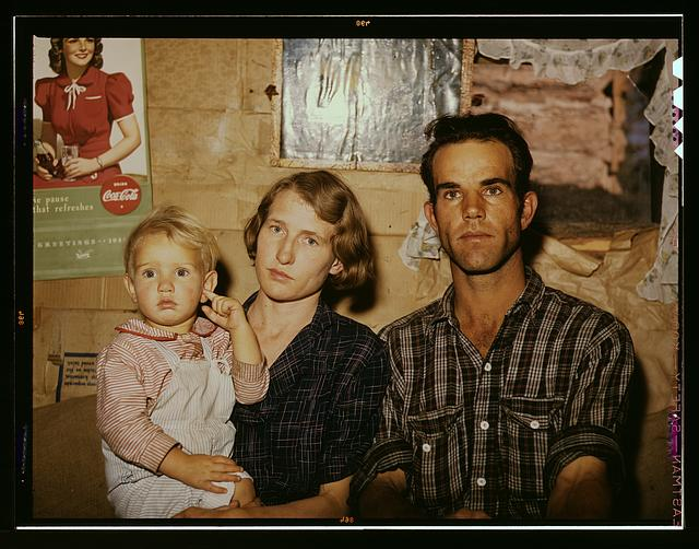 Jack Whinery, homesteader, with his wife and the youngest of his five children, Pie Town, New Mexico
