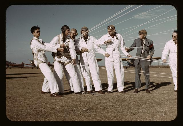 Instructor explaining the operation of the parachute to students, Meacham Field, Fort Worth, Tex.