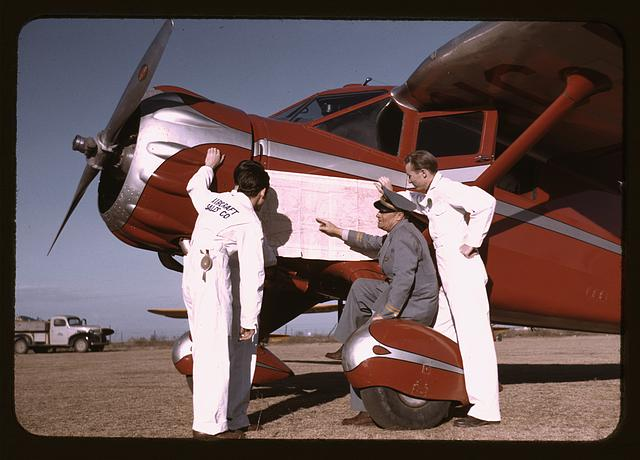 Instructor and students studying a map, Meacham Field, Fort Worth, Tex.