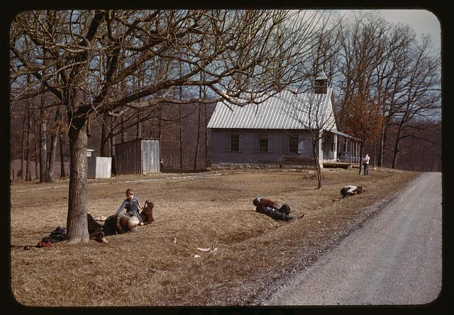 [Children playing by road near school house, Kansas?]