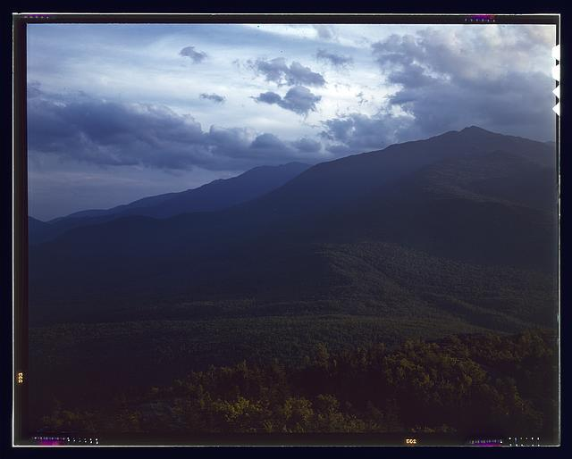 A view looking through the White Mountains from the fire control tower manned by Barbara Mortensen, a fire and airplane lookout on Pine Mountain, Gorham vicinity, N.H. View is to the south