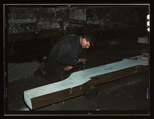 Section of a locomotive frame, which will be welded to replace a broken locomotive frame, Chicago, Ill. Workman is indicating what place must be cut. At the 40th Street shop of C&NWRR