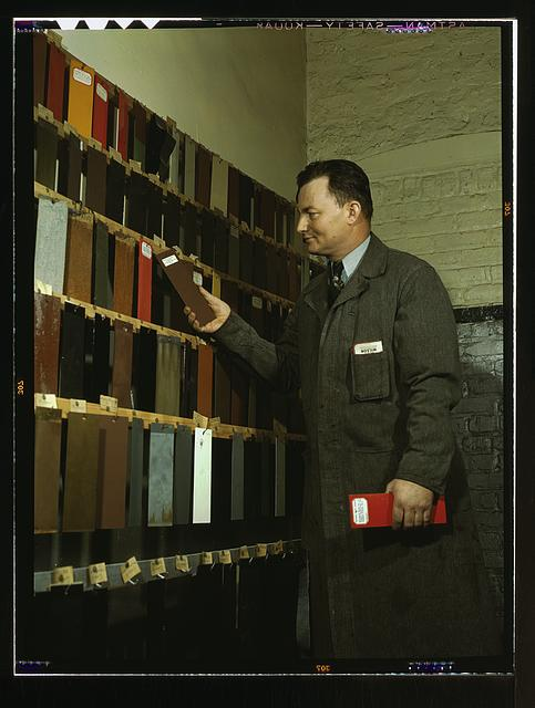 Laboratory worker at the research laboratory at the C & NW RR's 40th Street yard, examining paint samples used on freight cars and coaches of the railroad, Chicago, Ill.