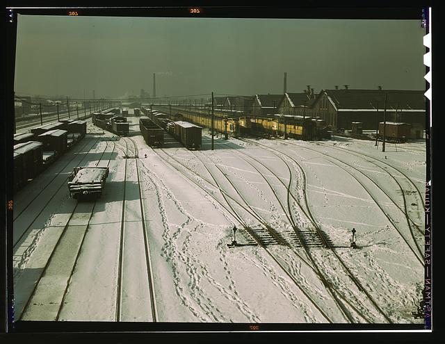 General view of yard and some of the locomotive shop of the C & NW RR at 40th Street. On the tracks on the right are three streamliners, crack trains, Chicago, Ill.
