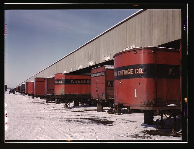 Truck trailers line up at a freight house to load and unload goods from the Chicago and Northwestern railroad, Chicago, Ill.