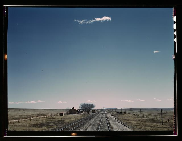 Passing a section house along the Atchison, Topeka, and Santa Fe railroad, Encino vicinity, New Mexico