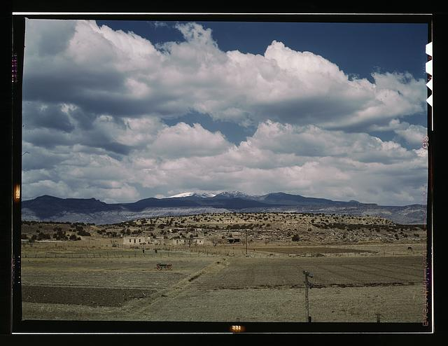 Indian houses and farms on the Laguna Indian reservation, Laguna N[ew] Mex[ico]. In the background is Mount Taylor. The Santa Fe R.R. crosses the reservation