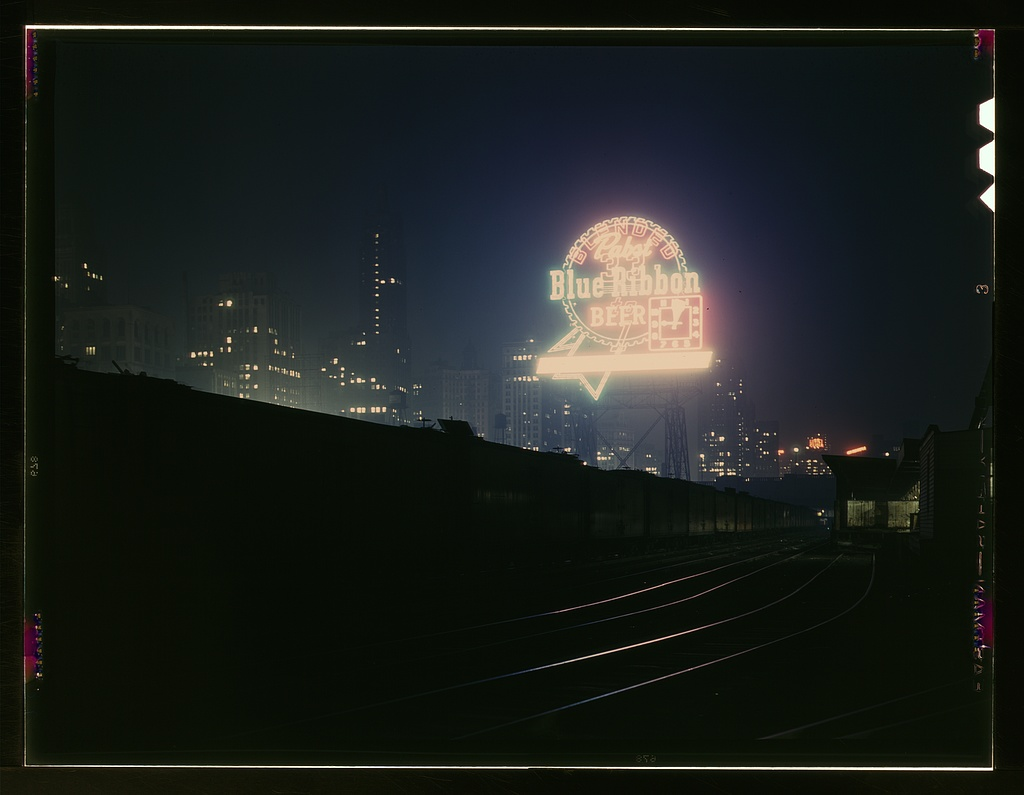 1943 Jack Delano photograph of Chicago's downtown freight terminal, below the Pabst Blue Ribbon sign