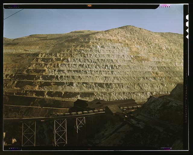 Open-pit workings of the Utah Copper Company, Bingham Canyon, Utah. This is the Carr Fork side from which the company obtains huge amounts of ore. The Carr Fork bridge and main shops appear in the foreground