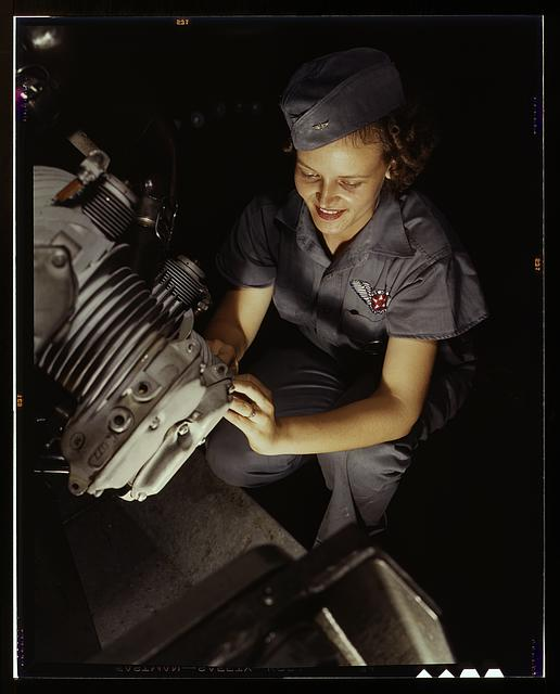 Assembly and Repairs Dept. mechanic Mary Josephine Farley works on a Wright Whirlwind motor, Naval Air Base, Corpus Christi, Texas