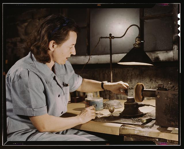 Formerly a sculptress and designer of tiles, Dorothy Cole converted her basement into a workshop to tin plate needles for valves for blood transfusion bottles prepared by Baxter Laboratories where she lives, Glenview, Ill. She turns in her profits to war bonds to provide a college education for her young nephew